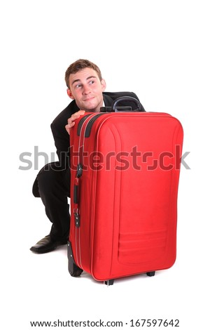 Funny business man hide behind red luggage - stock photo