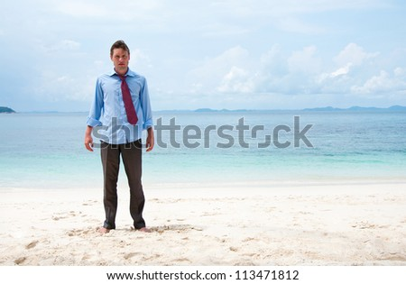 Funny business man on the beach - stock photo