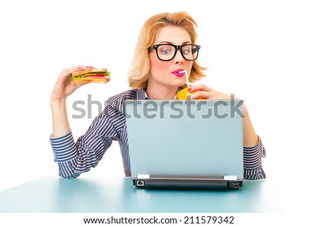 Funny business woman holding sandwich and drinking juice, isolatd on white. Studio shot - stock photo