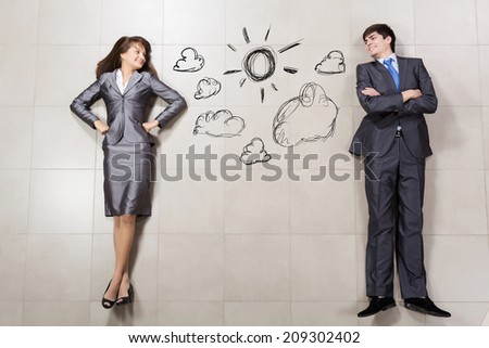 Funny businessman and woman lying on floor. Competition concept - stock photo
