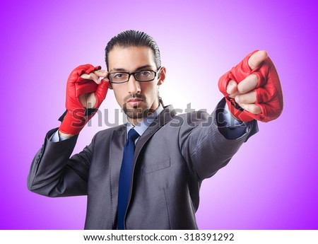Funny businessman with boxing gloves - stock photo