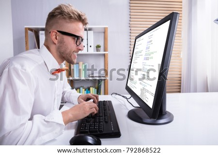 Funny Businessman Working On Computer In Office
