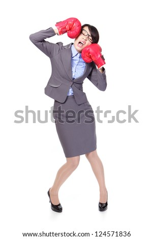 Funny businesswoman wearing boxing gloves and knock down itself, defeated loser woman - business concept - hopeless. Young Asian female model isolated on white background. - stock photo