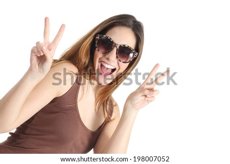 Funny casual teenager girl wearing fashion sunglasses gesturing victory isolated on a white background                   - stock photo