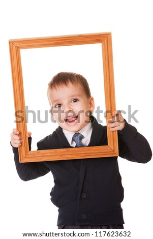Funny caucasian boy, holding a wooden picture frame. Isolated on white background - stock photo