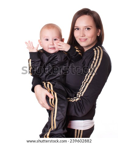Funny cheerful child and beautiful mother. Happy family. Sports wear