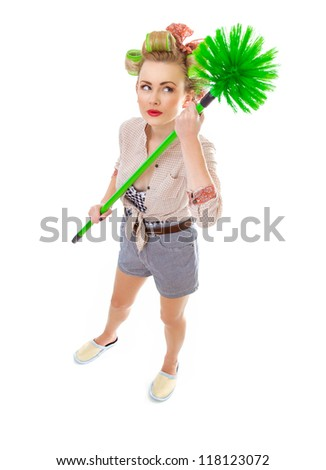 Funny cheerful housewife / girl with broom, isolated on white. Full length / total shot of domestic woman - stock photo