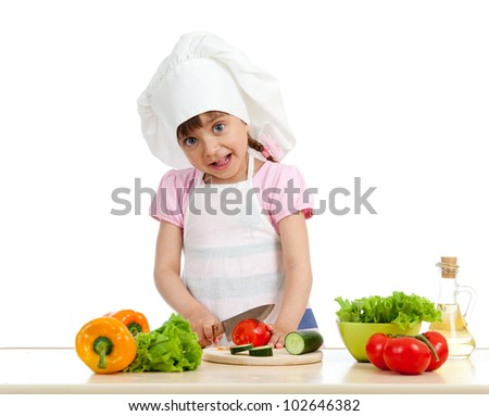 Funny chef girl preparing healthy food over white background - stock photo