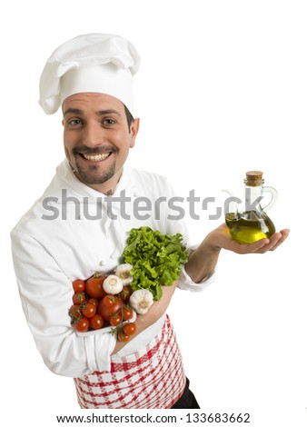 Funny chef with tomatoes, olive oil, garlic and salad - stock photo