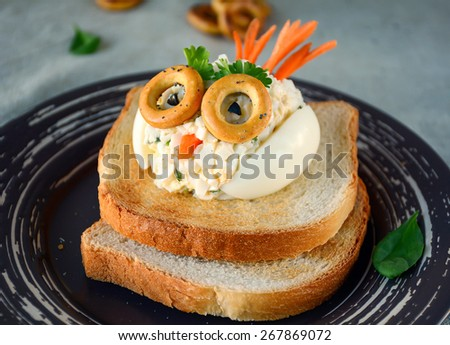 Funny chicken salad toast for kids. Healthy breakfast - stock photo