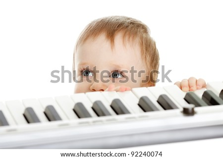 funny child behind electron piano - stock photo