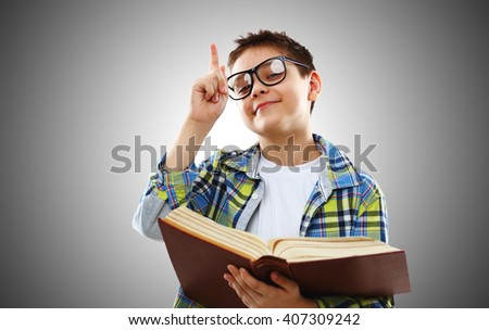 funny child boy teenager with glasses and book - stock photo