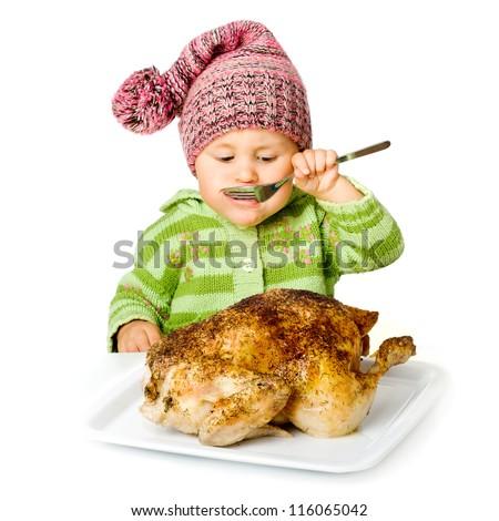 Funny child eating tasty turkey, isolated over white - stock photo