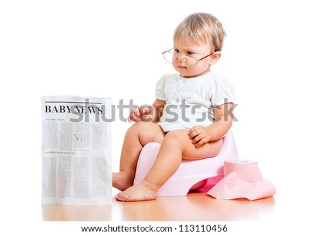 funny child girl reading newspaper on chamberpot - stock photo