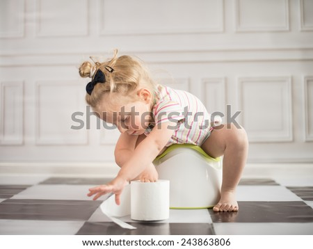 funny child girl sitting on chamberpot - stock photo