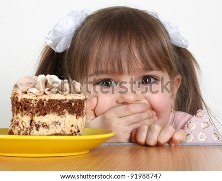 funny Child girl with cake - stock photo