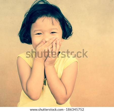 funny child girl with hands close to face - stock photo