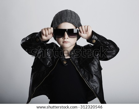 Funny child in hat.fashionable little boy in sunglasses. fashion trendy kids - stock photo