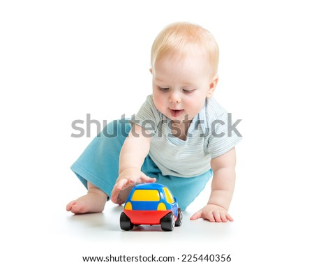 funny child kid playing with toy car - stock photo