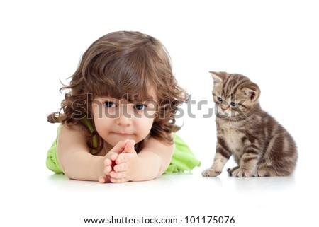 Funny child lying on floor. Scottish kitten sitting near girl. - stock photo