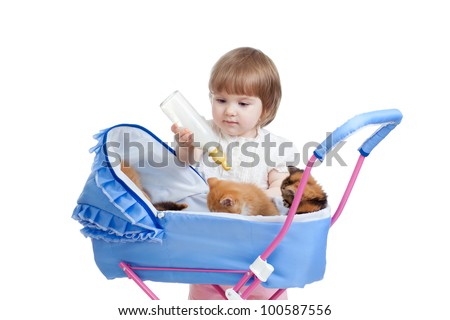 funny child playing with attractive kitten - stock photo