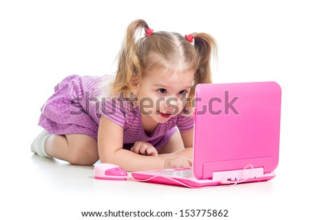funny child playing with laptop toy - stock photo