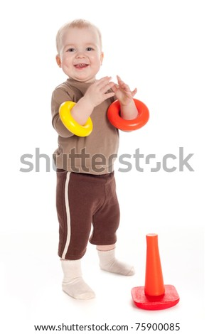 funny child plays with pyramide - stock photo