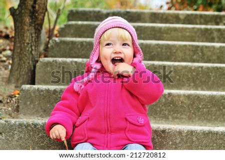 funny child showing her mouth - stock photo