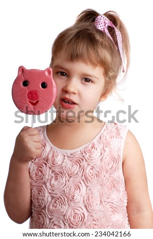 Funny child with a lollipop on an isolated background - stock photo