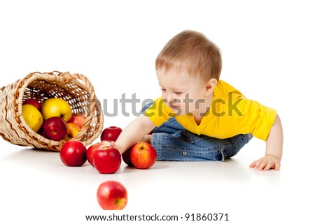 Funny child with basket filling apples - stock photo