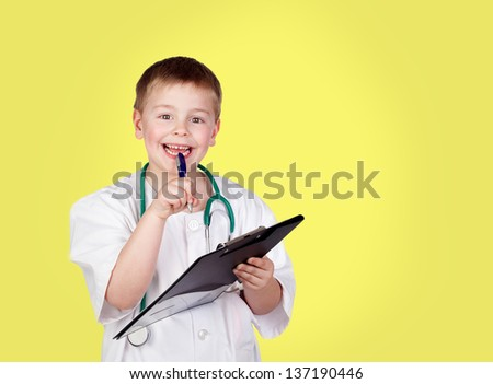 Funny child with doctor uniform on a yellow background - stock photo