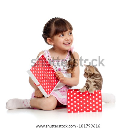 funny child with kitten in gift box - stock photo