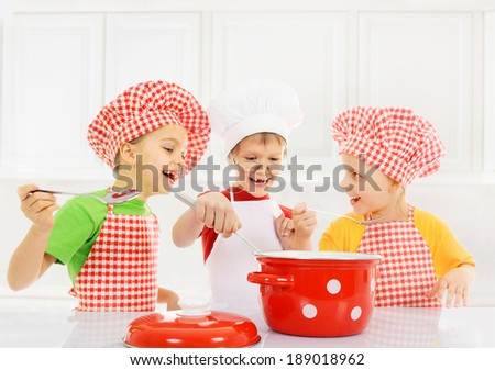 Funny children cooking in the kitchen - stock photo
