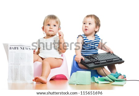 funny children girl and boy sitting on chamberpot with newspaper and keyboard - stock photo