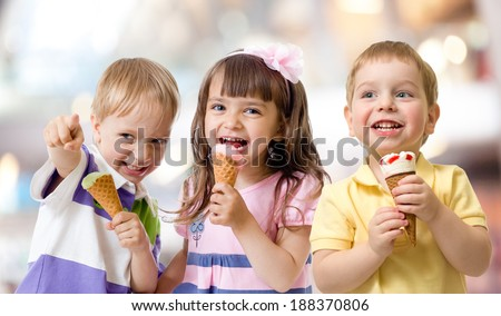funny children group kidding with ice cream on party - stock photo