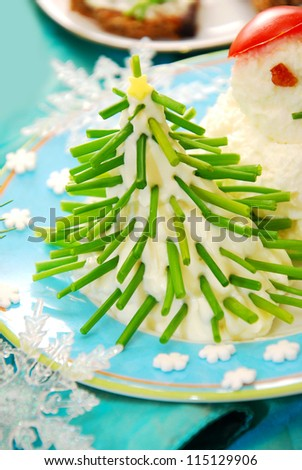 funny christmas breakfast with christmas tree made from cheese and chive for child - stock photo
