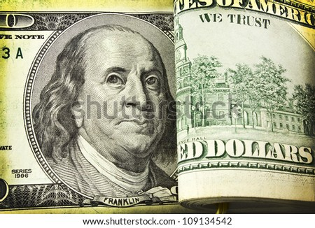 funny close-up portrait of Franklin with hundred dollar bills