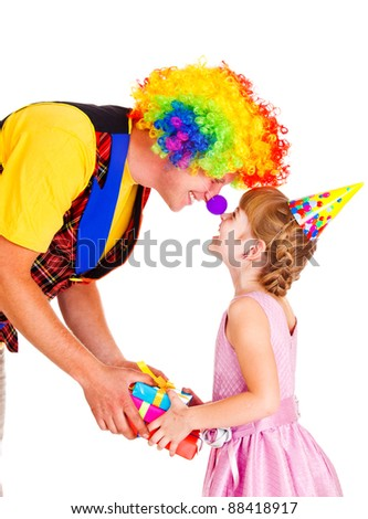 Funny clown giving present to a little girl - stock photo