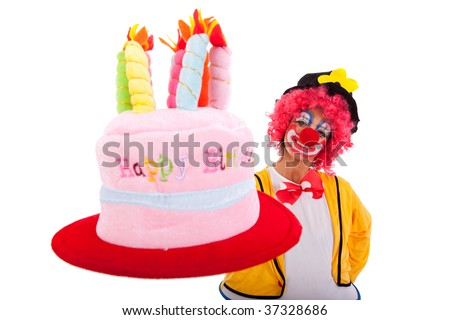 funny clown holding a birthday cake hat (isolated on white) - stock photo