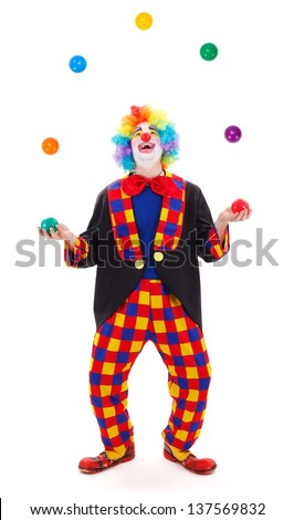 Funny clown juggling with colorful balls - stock photo