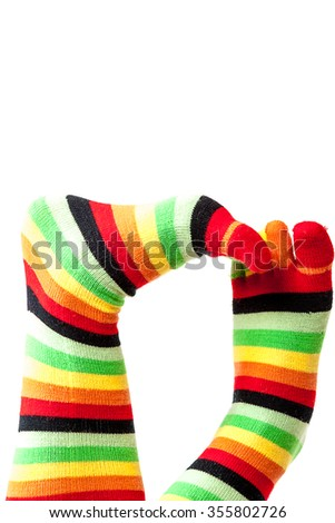 Funny colored socks female legs isolated on a white background. - stock photo