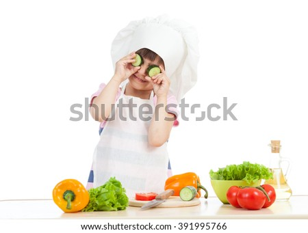 Funny cook child girl cooking at kitchen - stock photo