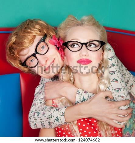 Funny couple embracing - stock photo