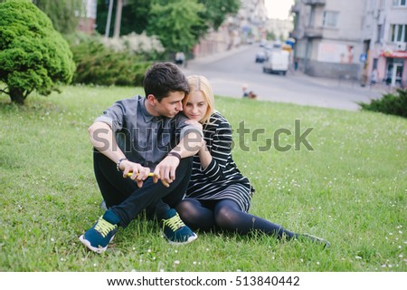 funny couple walking in the city and the park and eat ice cream