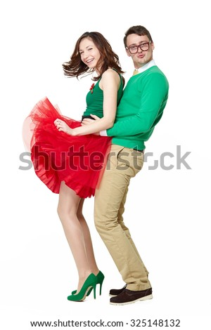 Funny couple wearing eyeglasses dancing. Full body portrait of comic nerd young man and woman feeling happy together isolated on white. Freedom and joy - stock photo