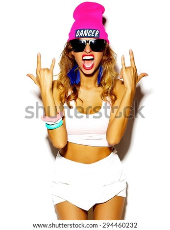 Funny crazy glamor stylish sexy smiling beautiful blond young woman model dancer in  bright hipster summer cloth in pink beanie  - stock photo