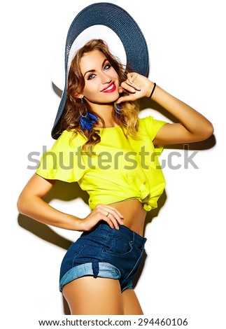 Funny crazy glamor stylish sexy smiling beautiful blond young woman model in summer bright hipster  yellow cloth in hat - stock photo