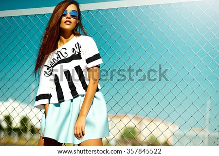 Funny crazy glamor stylish sexy smiling beautiful young woman model in  bright hipster summer casual cloth  in the street behind blue sky - stock photo