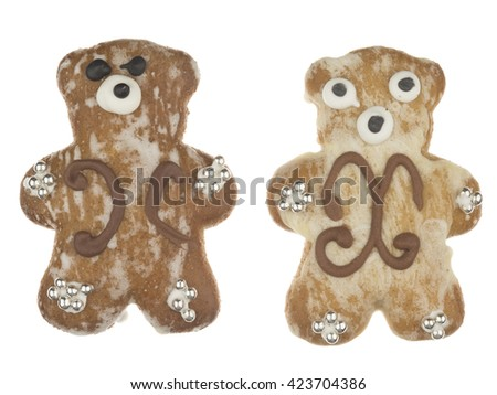 funny cute delicious gingerbread bear pattern and decorated with silver sugar balls isolated on white background - stock photo