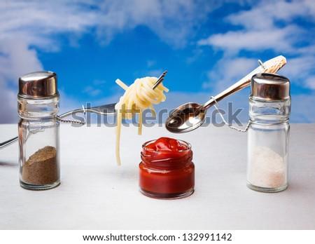 funny cutlery salt shaker and pepper eat Italian pasta - stock photo
